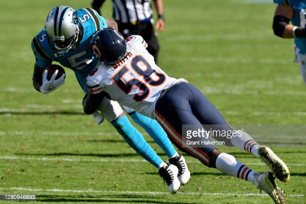 Teddy Bridgewater of the Carolina Panthers runs with the ball while being tackled by Roquan Smith of the Chicago Bears in the fourth quarter at Bank...