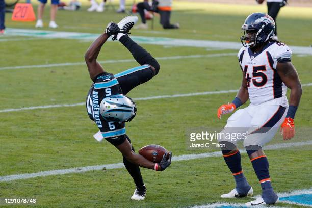 Teddy Bridgewater of the Carolina Panthers scores a seven-yard rushing touchdown against the Denver Broncos during the fourth quarter at Bank of...