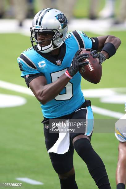 Teddy Bridgewater of the Carolina Panthers scrambles from the pocket during the first half of a game against the Los Angeles Chargers at SoFi Stadium...