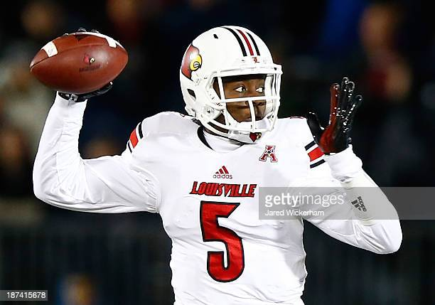 Teddy Bridgewater of the Louisville Cardinals drops back to throw a pass against the Connecticut Huskies at Rentschler Field in the first quarter...