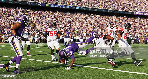 Teddy Bridgewater of the Minnesota Vikings dives into the end zone for a touchdown against the Atlanta Falcons on September 28, 2014 at TCF Bank...