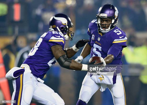 Teddy Bridgewater of the Minnesota Vikings hands the ball off to teammate Adrian Peterson during the first quarter of the game against the New York...