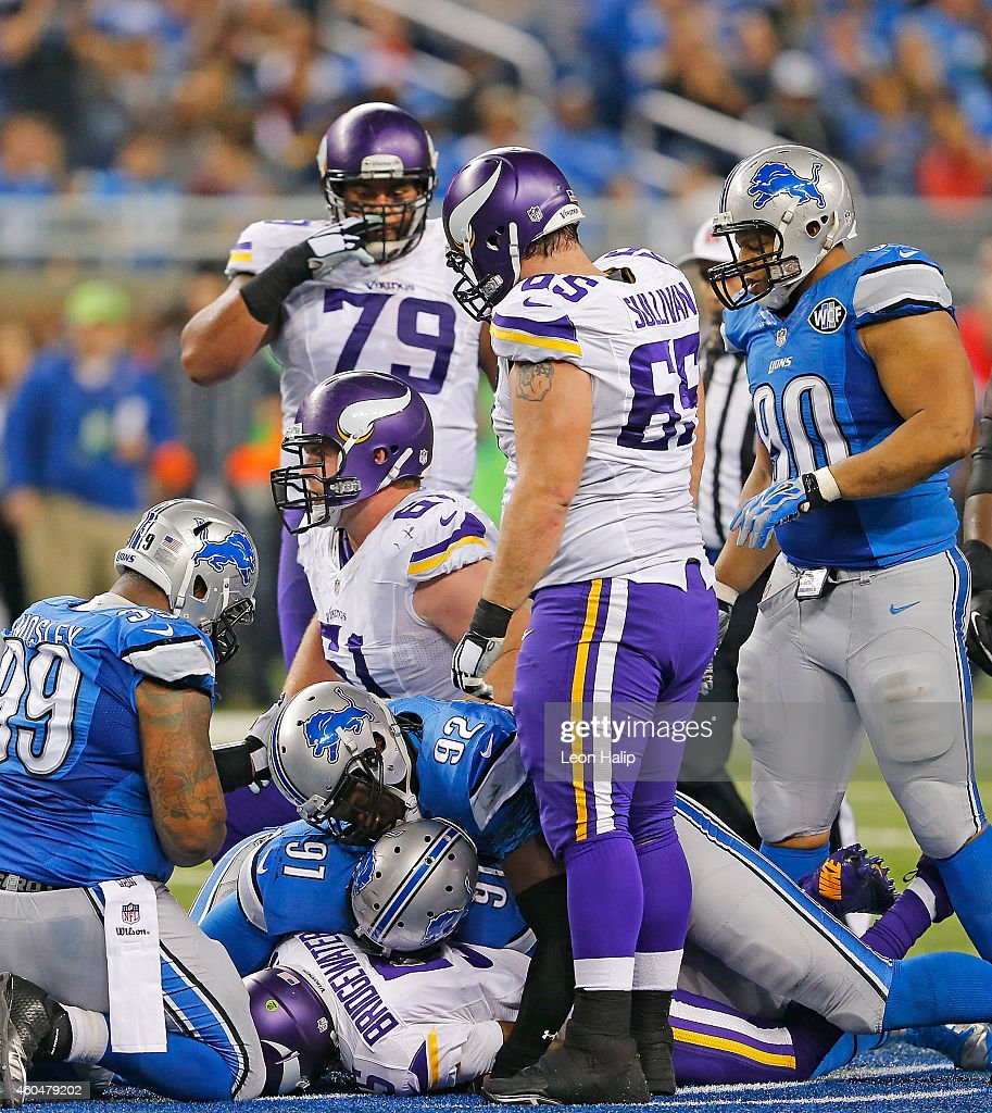 Teddy Bridgewater #5 of the Minnesota Vikings is sacked by Devin Taylor #92 and Jason Jones #91of the Detroit Lions during the fourth quarter of the game at Ford Field on December 14, 2014 in Detroit, Michigan. The Lions defeated the Vikings 16-14.
