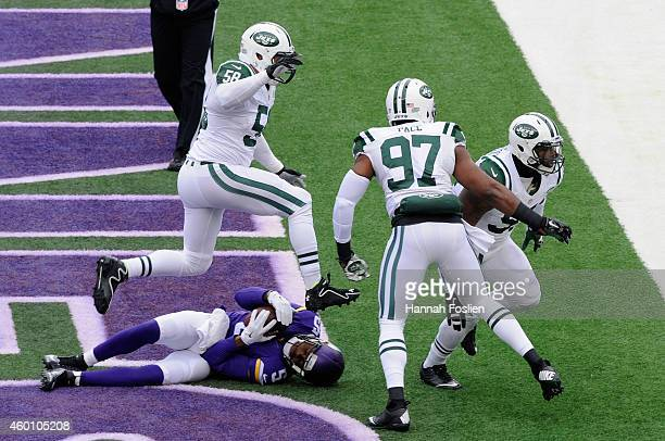 Teddy Bridgewater of the Minnesota Vikings lays in the end zone as Jason Babin Calvin Pace and Sheldon Richardson of the New York Jets celebrate a...
