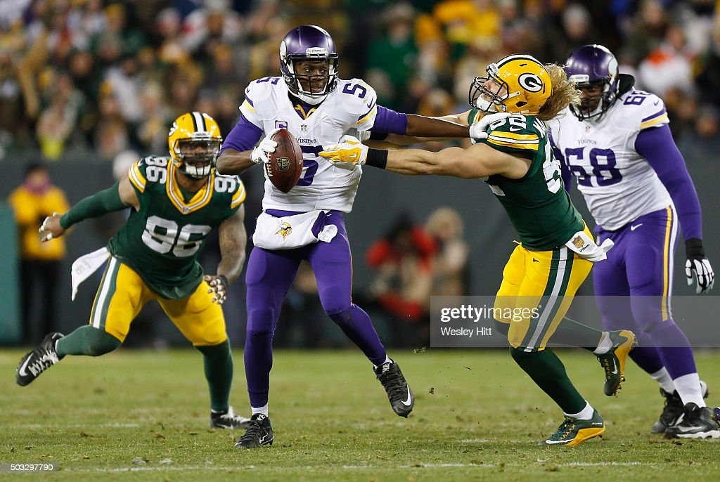 Teddy Bridgewater #5 of the Minnesota Vikings stiff arms Clay Matthews #52 of the Green Bay Packers during the second quarter of their game at Lambeau Field on January 3, 2016 in Green Bay, Wisconsin.