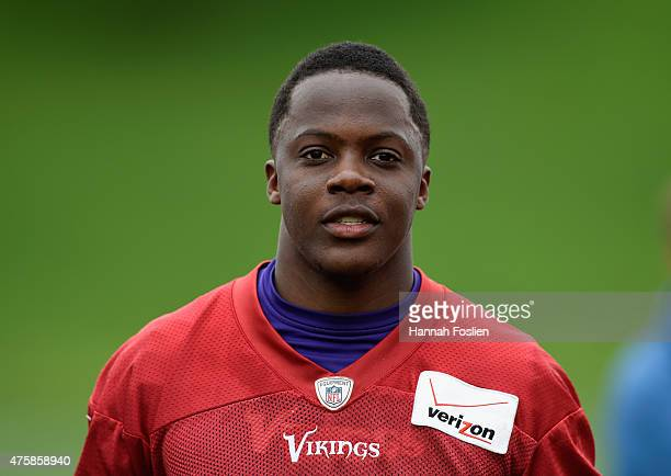Teddy Bridgewater of the Minnesota Vikings walks off the field after practice on June 4 2015 at Winter Park in Eden Prairie Minnesota