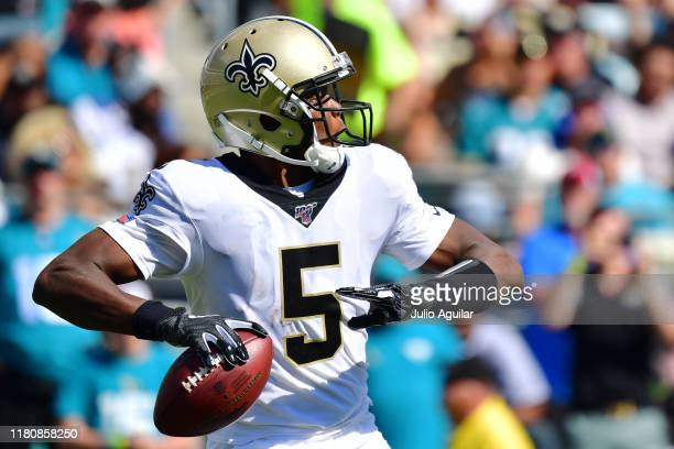 Teddy Bridgewater of the New Orleans Saints looks to throw a pass during the third quarter of a football game against the Jacksonville Jaguars at...