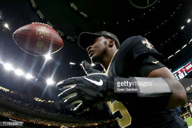 Teddy Bridgewater of the New Orleans Saints runs off the field after his team defeated the Tampa Bay Buccaneers 31 - 24 at the Mercedes Benz...