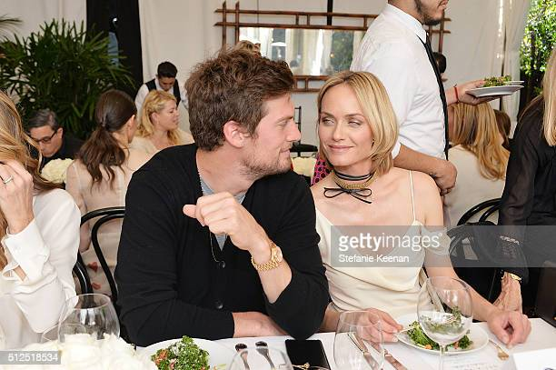 Teddy Charles and model Amber Valletta attend NETAPORTER Celebrates Women Behind The Lens at Chateau Marmont on February 26 2016 in Los Angeles...