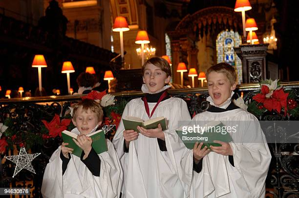 Teddy Collings left Kit Irwin center and George Raikes choristers of the St Paul's Cathedral Choir rehearse for their Christmas carol service at St...