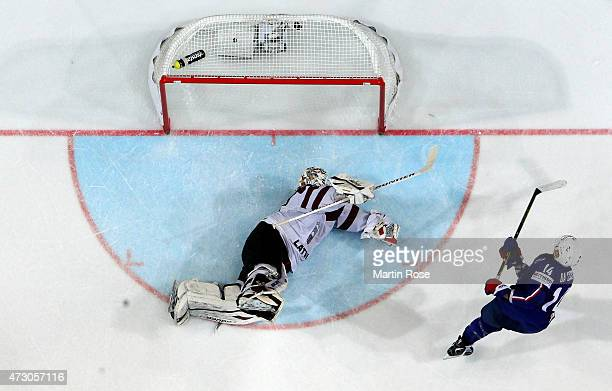 Teddy da Costa of France scores over Edgars Masalskis goaltender of Latvia during the IIHF World Championship group A match between Latvia and France...