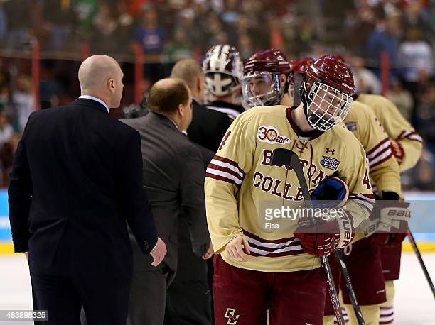 Teddy Doherty of the Boston College Eagles skates off the ice after shaking hands with the winning Union College Dutchmen during the 2014 NCAA...
