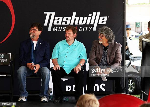 Teddy Gentry Jeff Cook and Randy Owen from Alabama awaits their introduction before receiving a star on the Music City Walk of Fame in 'Walk of Fame...