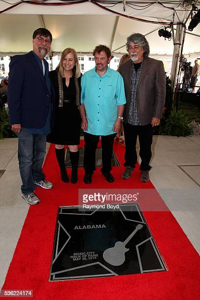Teddy Gentry Jeff Cook and Randy Owen from Alabama poses for photos with Nashville's Mayor Megan Barry after receiving a star on the Music City Walk...