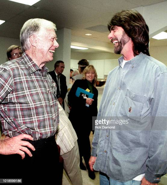 Teddy Gentry of Country Group Alabama and Former President Jimmy Carter backstage at Peachtree City Amphitheater Circa 1984 in Atlanta Georgia
