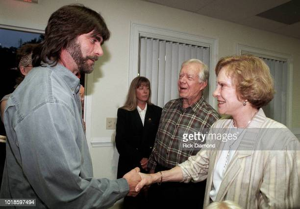 Teddy Gentry of Country Group Alabama Former President Jimmy Carter and Former First Lady Rosalynn Carter backstage at Peachtree City Amphitheater...