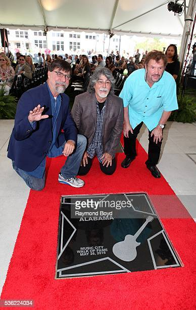 Teddy Gentry Randy Owen and Jeff Cook from Alabama poses for photos after receiving a star on the Music City Walk of Fame in 'Walk of Fame Park' in...