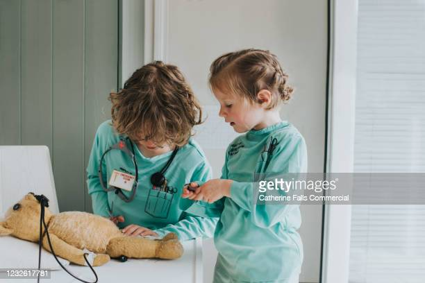 teddy has surgery - doctor stock pictures, royalty-free photos & images
