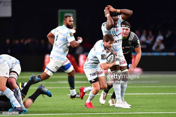 Teddy Iribaren of Racing 92 bounces off Yannick Nyanga of Racing 92 as he makes a break during the French Top 14 match between Racing 92 and Brive at...