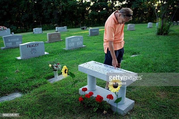 Teddy Johnson always traces his fingers along his son's name before leaving the gravesite at Spring Hill Cemetery Johnson found his son Adam dead of...