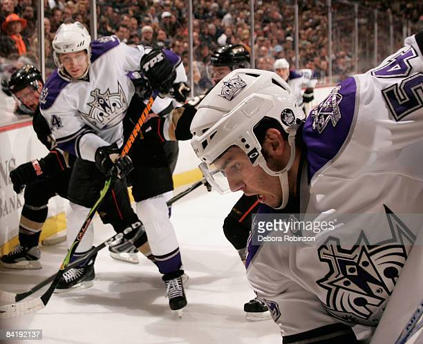 Teddy Purcell and Alexander Frolov of the Los Angeles Kings battle alongside the boards against the Anaheim Ducks during the game on January 6 2009...