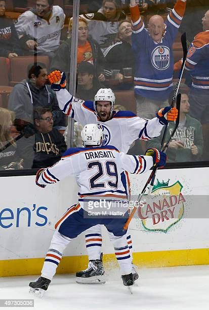 Teddy Purcell and Leon Draisaitl of the Edmonton Oilers react after a goal in overtime against the Anaheim Ducks at Honda Center on November 11 2015...