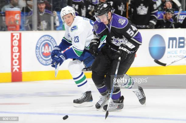 Teddy Purcell of the Los Angeles Kings skates with the puck against Alexander Edler of the Vancouver Canucks on October 29 2009 at Staples Center in...