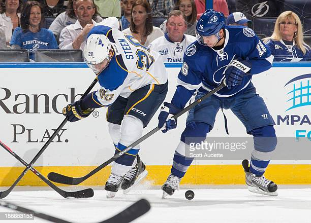 Teddy Purcell of the Tampa Bay Lightning battles for the puck against Alexander Steen of the St Louis Blues during the second period at the Tampa Bay...