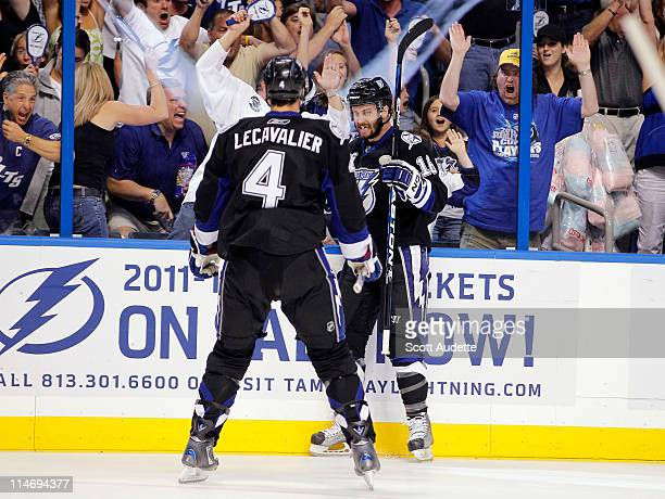 Teddy Purcell of the Tampa Bay Lightning celebrates his goal with teammate Vincent Lecavalier against the Boston Bruins during the first period in...