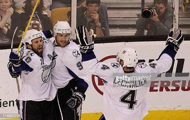 Teddy Purcell Steven Stamkos and Vincent Lecavalier of the Tampa Bay Lightning celebrate a first period goal against the Boston Bruins in Game Two of...