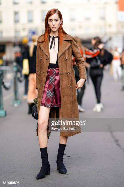 Teddy Quinlivan model wears a brown suede trench coat outside the Dries Van Noten show during Paris Fashion Week Womenswear Spring/Summer 2018 on...