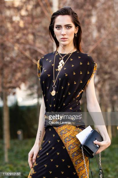 Teddy Quinlivan wearing a printed long dress black boots and black Louis Vuitton bag is seen outside Chloe on Day 4 Paris Fashion Week Autumn/Winter...