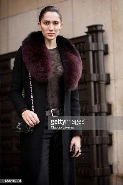 Teddy Quinlivan wearing a sheer black top black pants black Louis Vuitton bag and black coat with fur details is seen outside Haider Ackermann on Day...