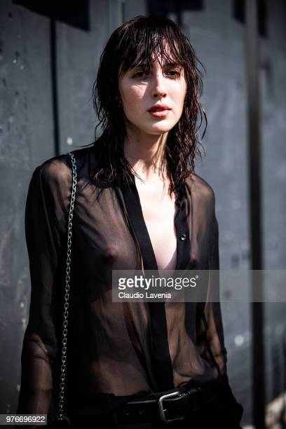 Teddy Quinlivan wearing see through shirt is seen in the streets of Milan after the Neil Barrett show during Milan Men's Fashion Week Spring/Summer...