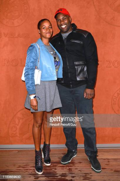 Teddy Riner and his companion Luthna Plocus attend the 2019 French Tennis Open - Day Eleven at Roland Garros on June 05, 2019 in Paris, France.