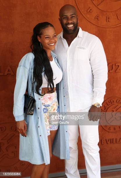Teddy Riner and his wife Luthna Plocus attend the Men's Singles Final during day 15 of the 2021 Roland-Garros, French Open, a Grand Slam tennis...