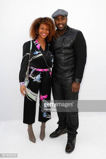 Teddy Riner and Luthna Plocus attend the Leonard Paris show as part of the Paris Fashion Week Womenswear Fall/Winter 2018/2019 on March 5 2018 in...