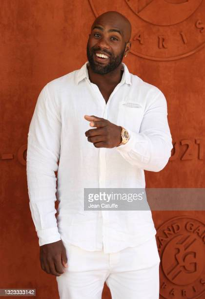 Teddy Riner attends the Men's Singles Final during day 15 of the 2021 Roland-Garros, French Open, a Grand Slam tennis tournament at Roland-Garros...