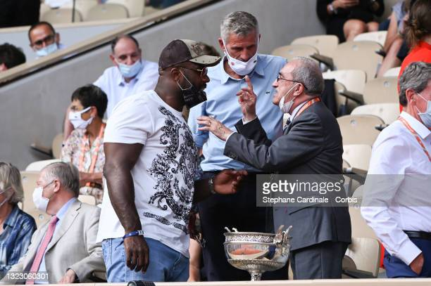 Teddy Riner, Gilles Moretton and Jean Gachassin attend the French Open 2021 at Roland Garros on June 11, 2021 in Paris, France.