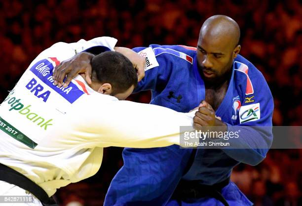 Teddy Riner of France and David Moura of Brazil compete in the Men's 100kg final during day six of the World Judo Championships at the Laszlo Papp...
