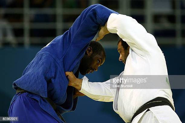 Teddy Riner of France battles Lasha Gujejiani of Georgia in the bronze medal contest in the men's 100 kg judo event at the University of Science and...