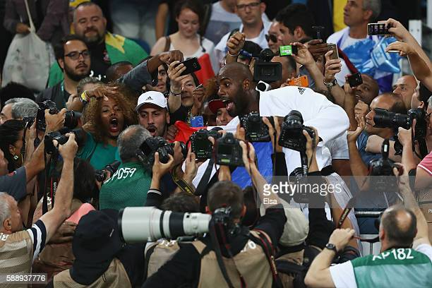 Teddy Riner of France celebrates after defeating Hisayoshi Harasawa of Japan during the Men's +100kg Judo Gold Medal contest on Day 7 of the Rio 2016...
