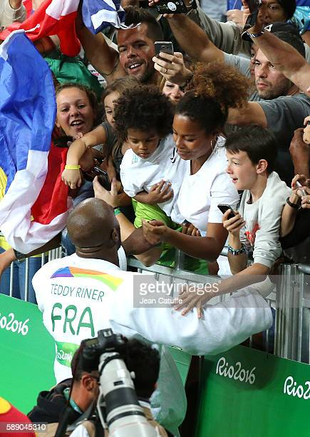 Teddy Riner of France celebrates with Luthna Plocus and their son Eden Riner winning the gold medal in the Men 100kg Final on day 7 of the 2016 Rio...