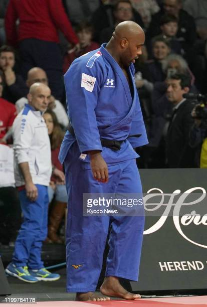 Teddy Riner of France looks dejected after being defeated by Kokoro Kageura of Japan in the third round of the Paris Grand Slam judo tournament over...