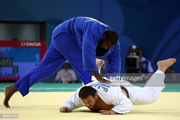 Teddy Riner of France throws down Lasha Gujejiani of Georgia in the bronze medal contest in the men's 100 kg judo event at the University of Science...
