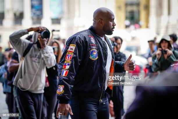 Teddy Riner World Judo Champion and Olympic champion wears a bomber jacket outside Cerruti during Paris Fashion Week Menswear SpringSummer 2019 on...