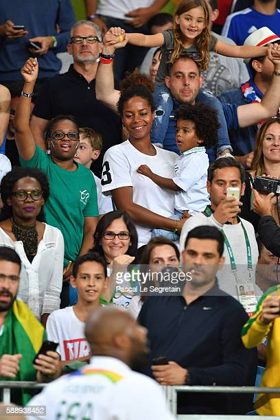 Teddy Riner's girlfriend Luthna Plocus and son Eden attend the Men's 100kg Judo finals on Day 7 of the Rio 2016 Olympic Games at Carioca Arena 2 on...