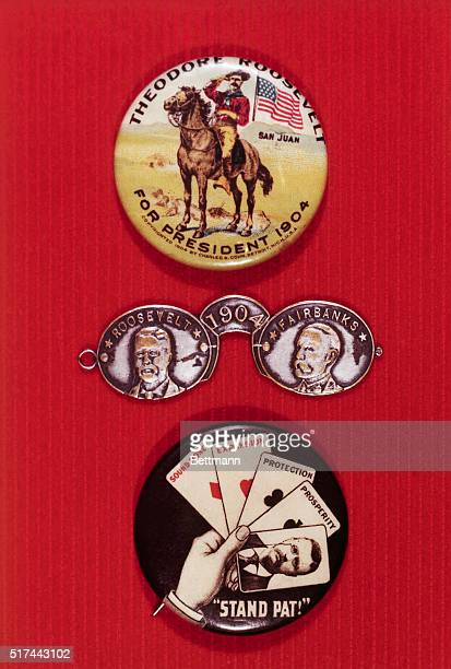 Teddy Roosevelt campaign of 1904 showing candidate as roughrider Humorous metal pin based on Teddy's pincenez and a hand of cards showing the...