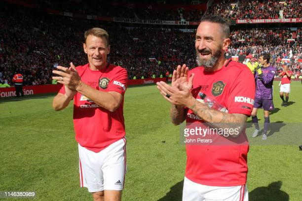 Teddy Sheringham and Karel Poborsky of Manchester United '99 Legends acknowledge the fans at the end of the 20 Years Treble Reunion match between...