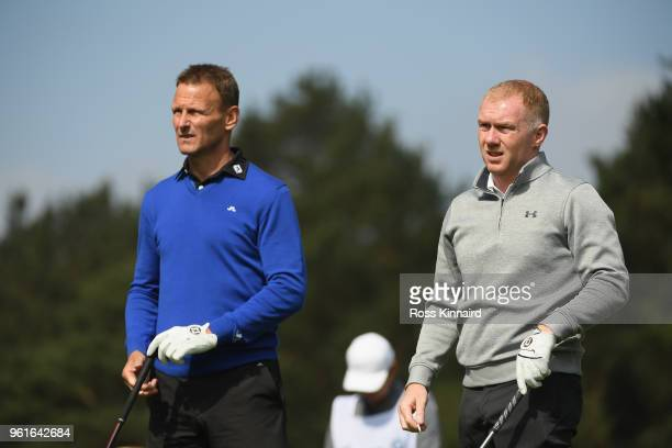 Teddy Sheringham and Paul Scholes look on during the Pro Am for the BMW PGA Championship at Wentworth on May 23 2018 in Virginia Water England